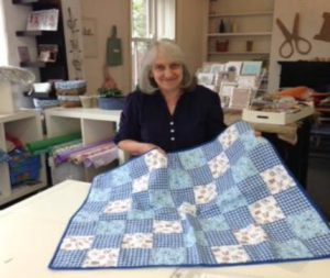 Gill with her quilt